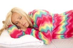 Woman in colorful pajamas lay asleep Royalty Free Stock Image