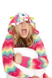 Woman in colorful pajamas sit hold pillow scream Royalty Free Stock Images