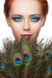 Woman with colorful peacock makeup Royalty Free Stock Photo