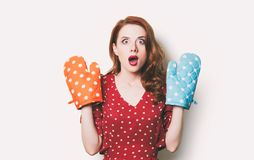 Woman with colorful potholders Royalty Free Stock Images