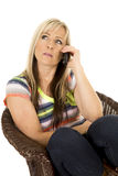 Woman in colorful shirt looking up and talking on phone Royalty Free Stock Images