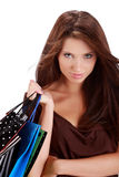 Woman with colorful shopping bag Stock Images