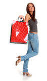 Woman with colorful shopping bags. Stock Image
