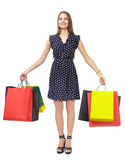 Woman with colorful shopping bags Stock Images