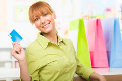 Woman with colorful shopping bags holding credit card Royalty Free Stock Photo