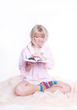 Woman in colorful strip socks reading a book Royalty Free Stock Images