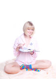 Woman in colorful strip socks reading a book Stock Image