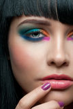 Woman with colorful stylish make-up Stock Images