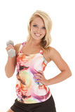 Woman in a colorful tank fitness smile  weight Stock Photography