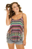 Woman colorful tank top stand twirl hair Royalty Free Stock Photography