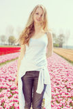 Woman in colorful tulip field Royalty Free Stock Images