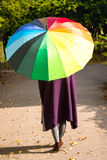 Woman with colorful umbrella isolated Stock Photos