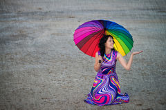 Woman with colorful umbrella under the rain Stock Images