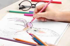 Woman coloring anti stress picture royalty free stock photo