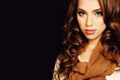 Woman with Coloring Curly Hair. Beautiful Girl Wearing Scarf Stock Image