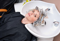Woman with coloring foil Royalty Free Stock Photos