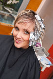 Woman with coloring foil Stock Image