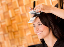 Woman coloring her hair Stock Image