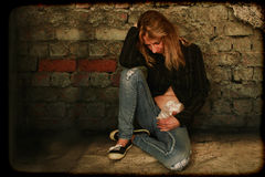Woman With a Colostomy Bag. Woman feeling hopeless and sad wearing a colostomy bag Royalty Free Stock Images