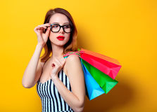 Woman with colour shopping bags Royalty Free Stock Images