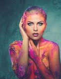Woman with colourful body art Royalty Free Stock Images