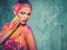 Woman with colourful body art Royalty Free Stock Photography