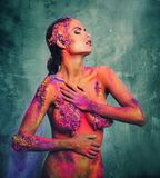 Woman with colourful body art Stock Photography
