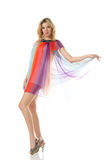 Woman in colourful dress dancing Royalty Free Stock Image