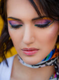 Woman with colourful makeup Stock Image