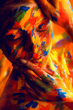 Woman in colourful paint on skin Royalty Free Stock Images