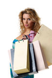 Woman with colourful shopping bags Stock Photos