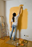 Woman colours her apartment