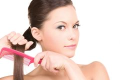Woman with comb Royalty Free Stock Photography