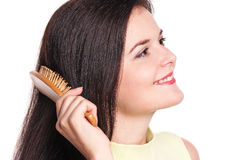 Woman comb hairs Stock Photography