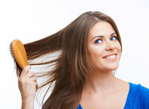 Woman comb long hair Stock Photography