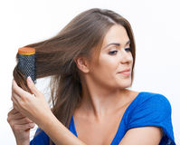 Woman comb long hair Stock Photos