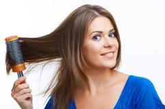 Woman comb long hair Royalty Free Stock Image