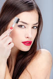 Woman combing eyebrow Stock Photography