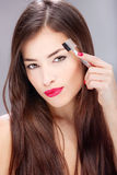 Woman combing eyebrow Royalty Free Stock Image