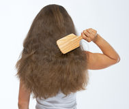 Woman combing hair . rear view Stock Photo