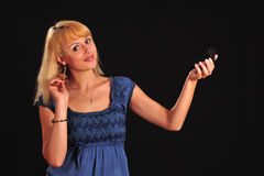 Woman combing her hair Stock Photography
