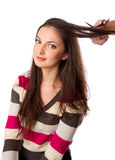Woman is combing her hair Stock Photos