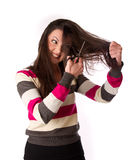 Woman is combing her hair Stock Images