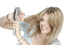 Woman combing her hair Stock Image
