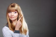 Woman combing her hair with comb Stock Photography