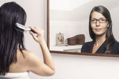 Woman Combing her Hair with Different Reflection Stock Photography