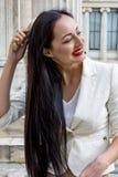 Woman combing her hair outdoors stock photos