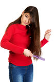 Woman combing her tangled hair. Royalty Free Stock Image