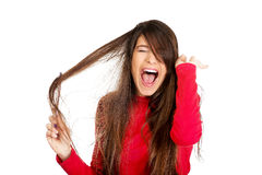 Woman combing her tangled hair. Stock Images