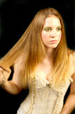 Woman combing long hair Royalty Free Stock Images